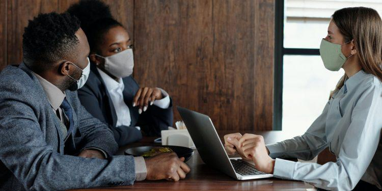 business-people-wearing-face-masks-and-talking-4427926-750x375