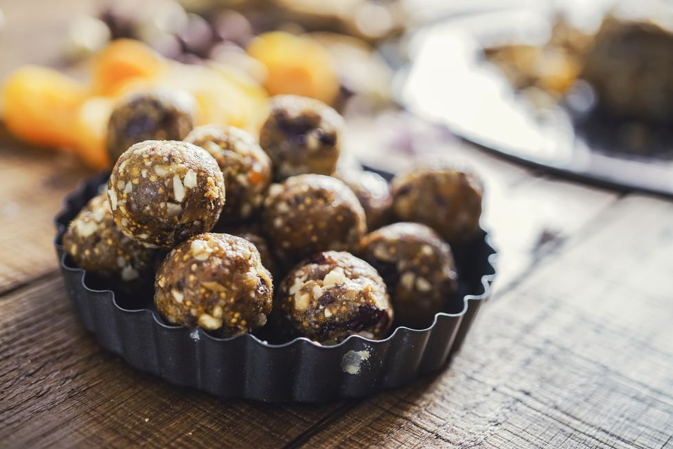 healthy-energy-balls-made-of-dried-fruits-and-nuts-royalty-free-image-1573042395